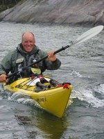 James Baxter paddling down the 3300 km coastline  of Norway
