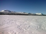 Day 81. Skiing across the Tjieggelvas lake with the mountains to the west of it