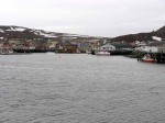 Day 140.2 a view across some of the harbour at Kiberg with one of the wharfs