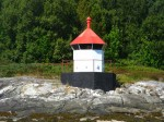 Day 196.1 A navigation beacon on the shore of Leka is iconic of the entire coast