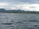 Day 200.1 The small lush island of Lauvoy in the foreground and the mountains between Frohavet and Stjornfjord behind