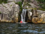 Day 230.5 Tom Amundsen washing his kayak under the waterfall in Egersund sound