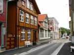 Day 232.1 One of the 150 year old streets in Egersund with original wooden houses on both sides.