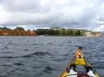 Day 245.3 Coming into Stavern with the large boatsheds along the shore