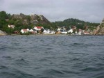 Day 246.2 The small village of Kjerringvik tucked away behind islands on thsi otherwise exposed coast.