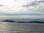 Day 181.6 Looking out of Buvag harbour to the jagged peaks of the Lofoten Islands to the north west