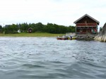Day 203.1 The boathouse and farm at Sandvika bay on Lesundoya island