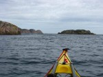 Day 335.4 Leaving Kjospoy and starting to cross the Gronsfjord to Lindesnes in the distance